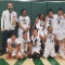 6th grade girls basketball team poses with the trophy