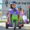 A child rides a big wheel during Safety Town