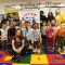 A Pre-k class poses with its 5-star rating banner