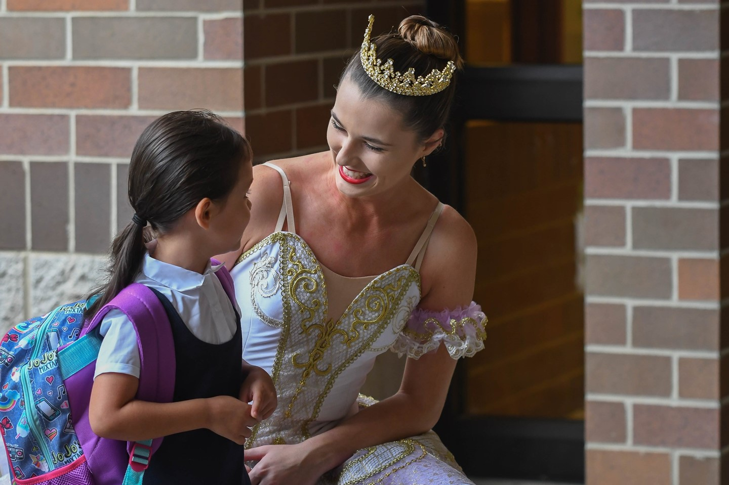 A ballet dancer welcomes a young scholar on the first day of school