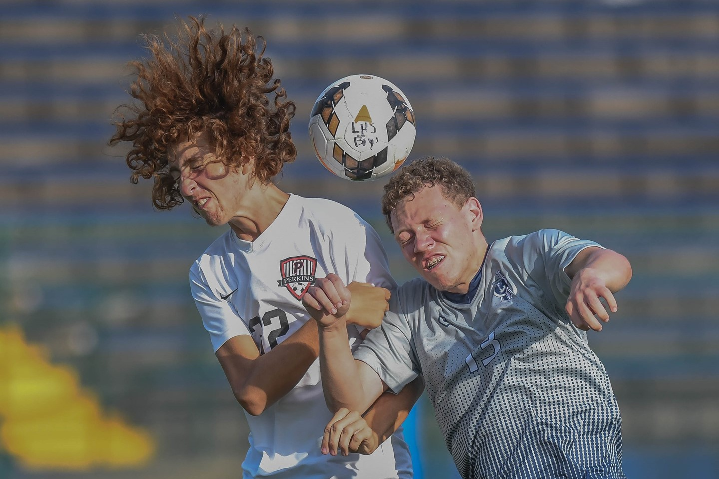 A Titans soccer player heads the ball