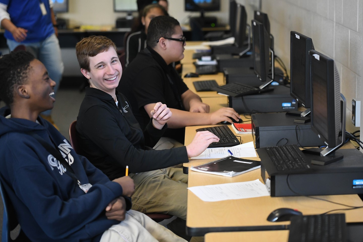 Scholars work on their computers at GJW